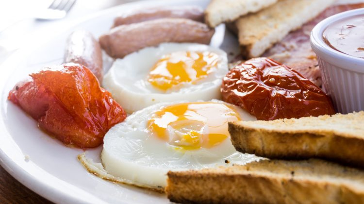Egg and Toast - classical english breakfast with egg and ham